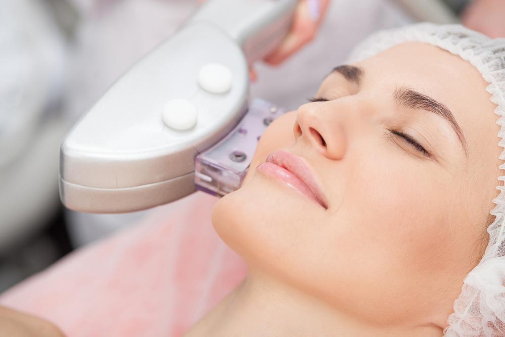 Lady receiving facial treatment